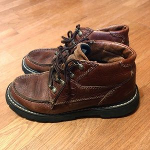 Ariat Ankle hiking lace up boots.